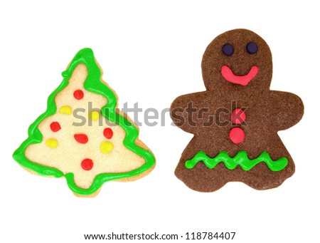 Isolated homemade cookies in the shape of Gingerbread Man and Christmas Tree.