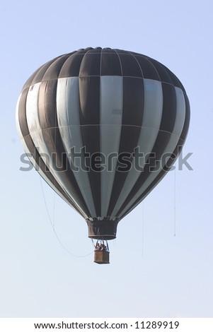 Isolated hot air balloon - stock photo