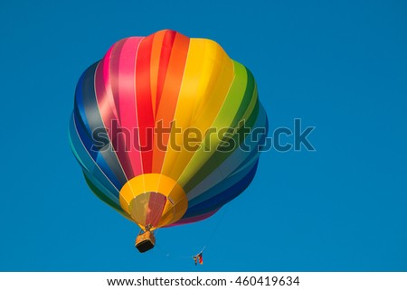 Isolated hot air balloon in blue sky