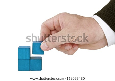 Isolated human hand finishing four blocks blue - stock photo