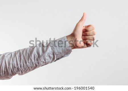 isolated human harm and hand with thumbs up, ok sign for approving like