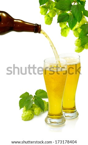 Isolated image of a bottle and two glasses of beer - stock photo