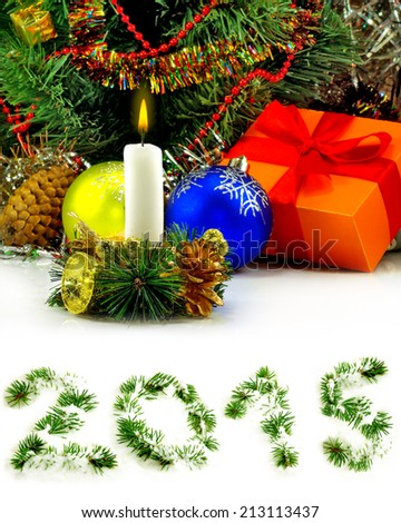 Isolated image of a burning candle on the  Christmas tree background