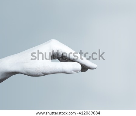 Isolated image of a hand painted in white paint in the pose of the roof of the house - stock photo