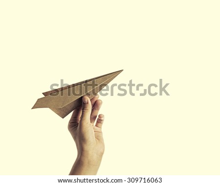 isolated image of a hand starts the paper plane