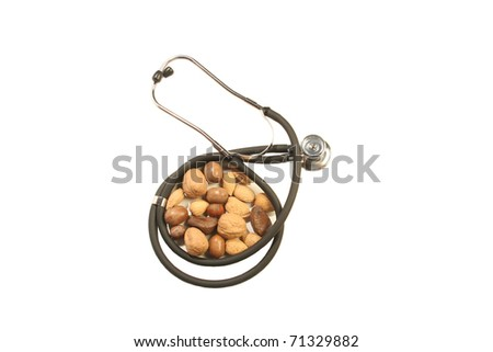 Isolated image of a stethoscope with mixed nuts - stock photo