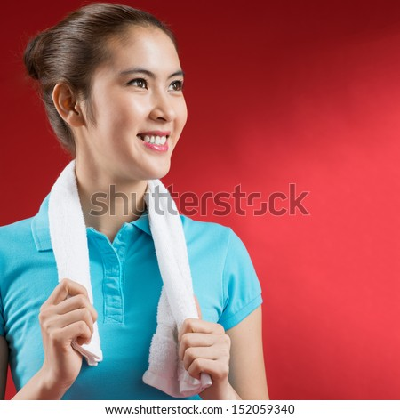 Isolated image of a sweating sportswoman over a red background - stock photo