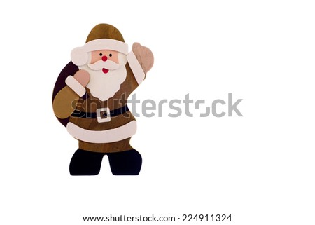 Isolated image of a traditional wooden figure of father Christmas - stock photo