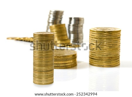 Isolated image of coins on a white background closeup - stock photo