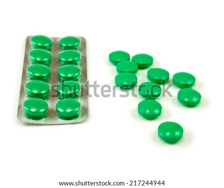 Isolated image of green pills on white background - stock photo