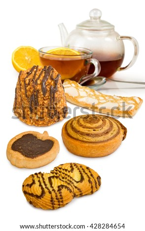 isolated image of tea and biscuits closeup - stock photo