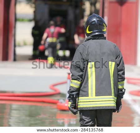 isolated Italian fireman with protective uniform and helmet