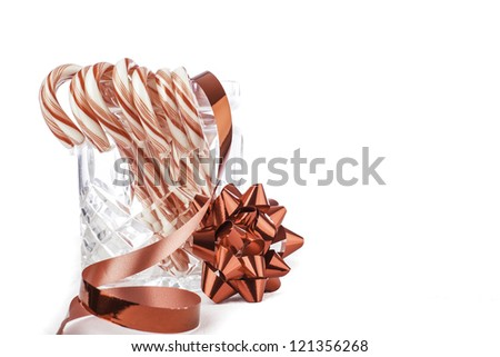 isolated jar of candy canes with space for custom text - stock photo