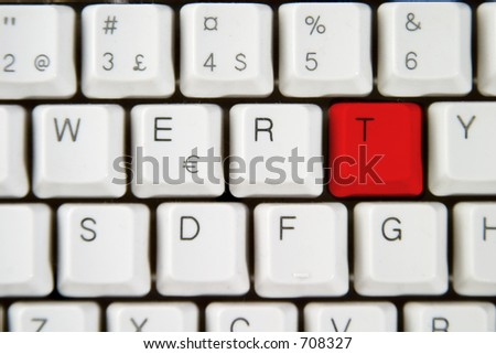 Isolated letter T on from a computer desktop keyboard highlighted in red