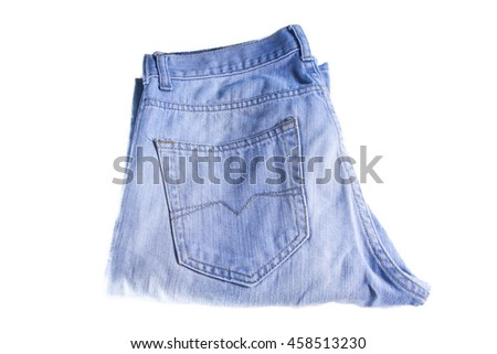 Isolated light blue jeans folded