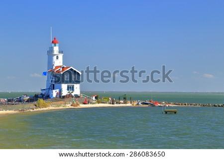 Isolated lighthouse on the seashore in Marken, Netherlands  - stock photo
