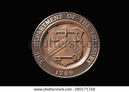 Isolated logo of United States Treasury Department with black background - stock photo