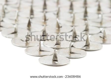 Isolated macro photo of a lot of pushpins - stock photo