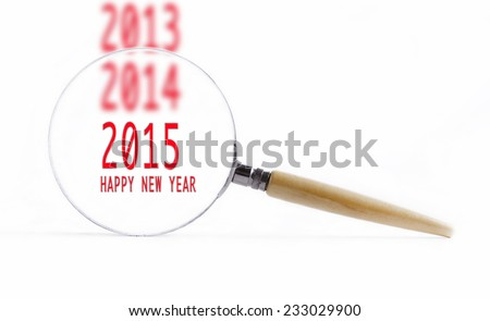 "Isolated Magnifying glass on white background searching missing puzzle peace ""new year 2015"" - stock photo"