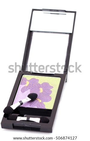 isolated makeup set: box of eye shadows, green and violet color on white
