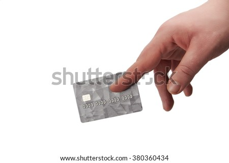 Isolated male hand giving a grey credit  card with chip - stock photo