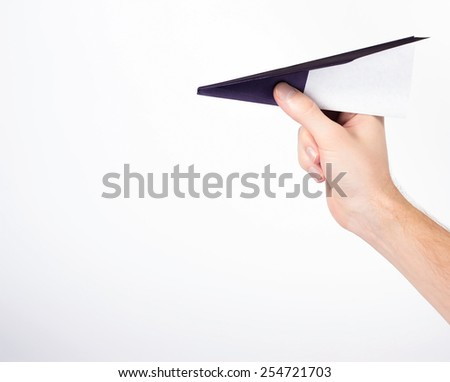 isolated male hand holding paper airplane