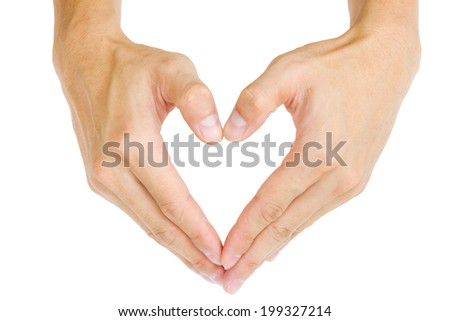 Isolated male hand showing heart shape. - stock photo