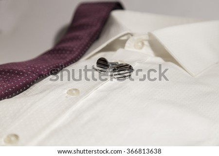 Isolated Man Shirt with cuff link and folded tie over white for design