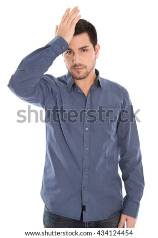 Isolated man with blue shirt shocked and depressed. - stock photo