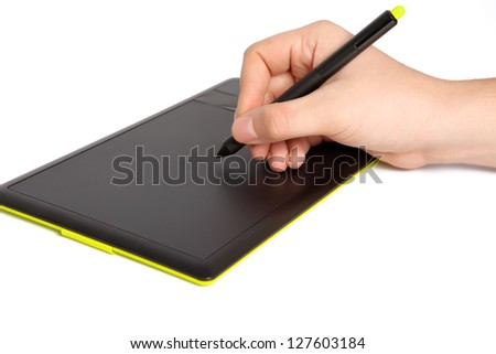 isolated mans hand draws a pen on a touch tablet - stock photo