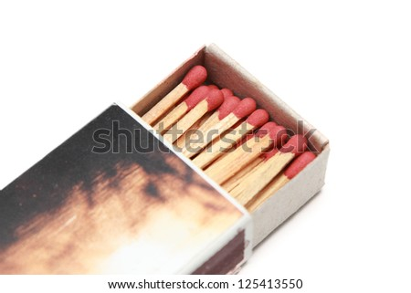 isolated matchstick in a matchbox - stock photo