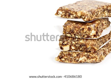 Isolated Medjool Date and Cashew Protein Bars isolated on white with light shadow and clipping path. - stock photo