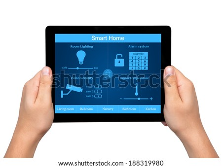 isolated men hands hold a tablet touch computer with system smart house on the screen - stock photo
