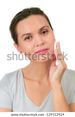 Isolated middle age woman with a cleansing puff - stock photo