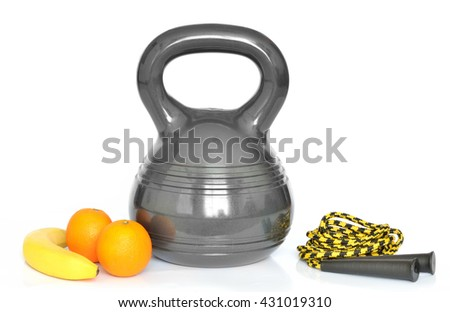 Isolated modern design kettlebell - 10kg, fresh fruit (banan, oranges) and yellow jumping rope on white background - stock photo