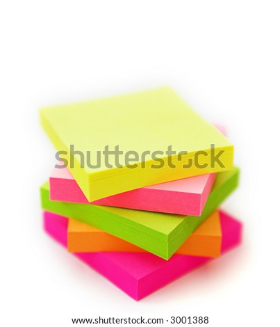 Isolated multi coloured post it notes stacked up - shallow dof - stock photo