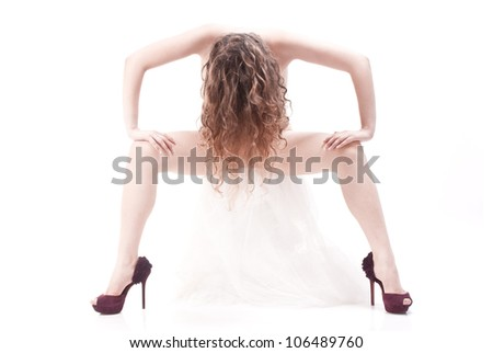 Isolated naked woman sitting on white towel