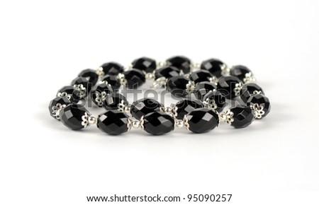 Isolated necklace of black stones - stock photo