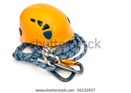 Isolated new climbing equipment - carabiner without scratches, orange helmet and blue rope - stock photo