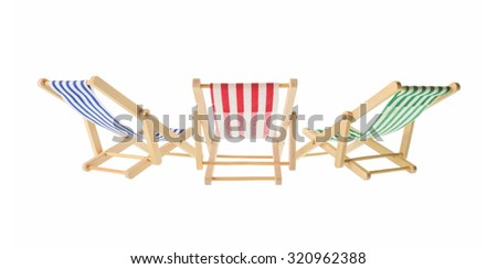 Isolated objects: group of wooden multicolored striped deck chairs, isolated on white background - stock photo