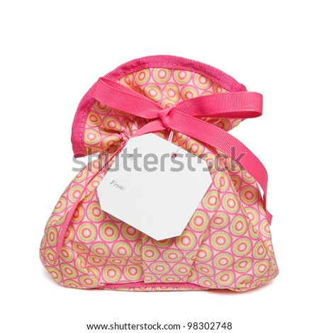 Isolated objects: ladies toiletry/beauty products bag on white background. Space for copy on the tag.