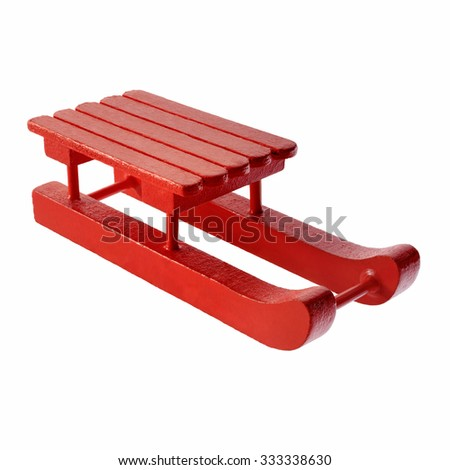 Isolated objects: red wooden sleigh toy, on white background - stock photo
