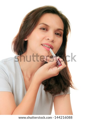 Isolated of a middle age asian woman with a lipstick - stock photo