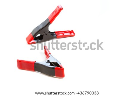 Isolated of small  spring clamp on white background