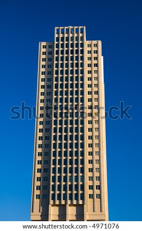 isolated office building tower in blue sky