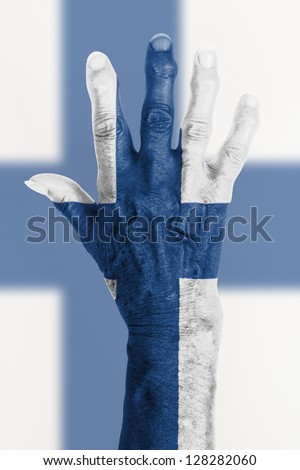 Isolated old hand with flag, European Union, Finland - stock photo