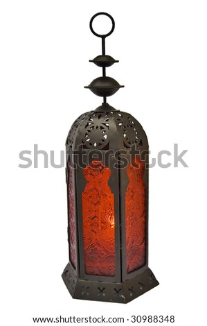 Isolated old lamp with candle inside - stock photo