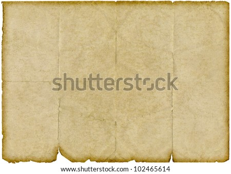 Isolated old vintage yellowing folded paper with torn edges. - stock photo