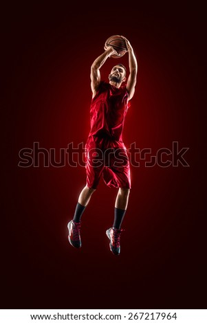 Isolated on black basketball player in action is flying high  - stock photo