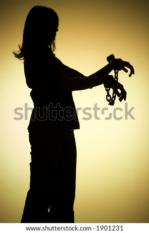 isolated on gold silhouette of woman with chains